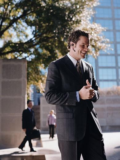 Businessman talking on cellphone headset : Stock Photo