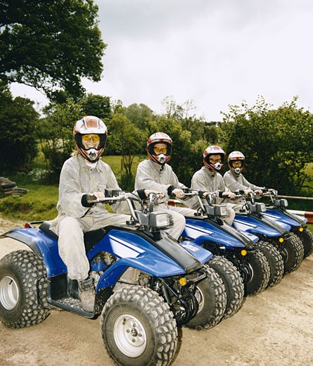 Stock Photo: 1598R-9983002 Men and Women Sitting on Quad Bikes