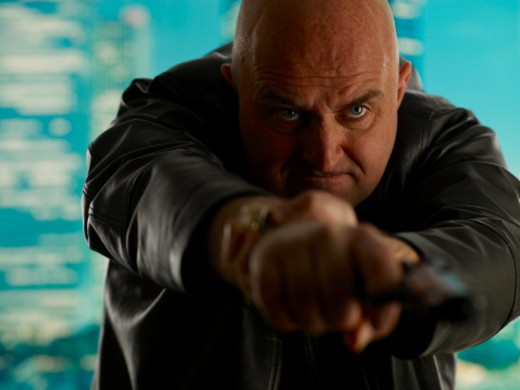 Stock Photo: 1598R-9984014 Bald man aiming gun, indoors