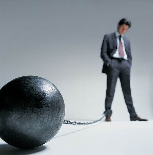 Stock Photo: 1598R-9984891 Businessman with a Ball and Chain