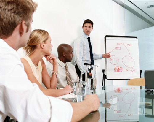 Businessman Gives a Presentation to Colleagues in a Meeting Room : Stock Photo