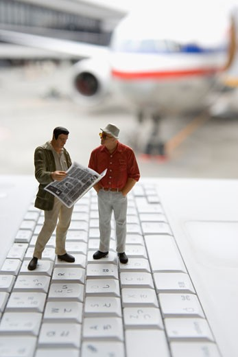 Stock Photo: 1598R-9985350 Figurine men standing on keyboard in airport