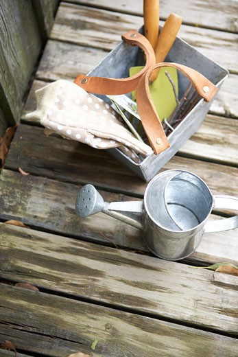 Antique gardening tools on damp wooden deck : Stock Photo