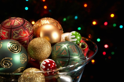 Stock Photo: 1598R-9985858 Christmas ornaments in glass bowl with Christmas lights in background