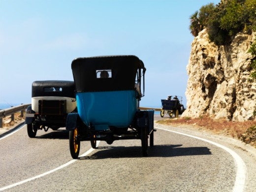 Stock Photo: 1598R-9986321 Old fashion cars at the  5o annivesary Barcelona- Sitges  Rally. Barcelona 2008. Focus is on the back of the  blue car.