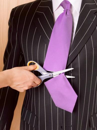Stock Photo: 1598R-9987897 Businessman having tie cut off