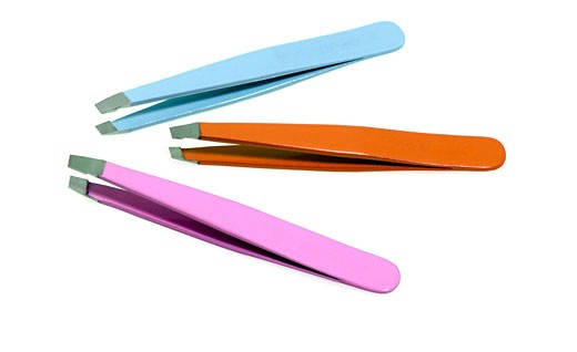tweezers are tools used for picking up small objects that are not easily handled with the human hands. They are probably derived from tongs, pincers, or scissors-like pliers used to grab or hold hot objects from the dawn of recorded history. : Stock Photo