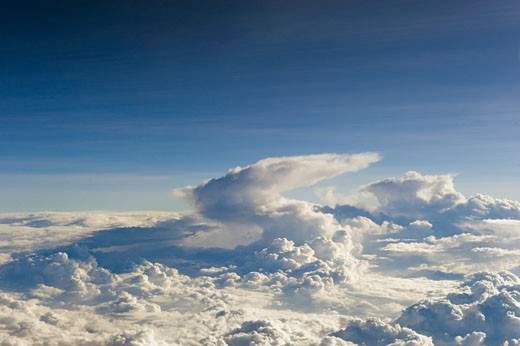 Stock Photo: 1598R-9990225 A billowy blanket of clouds seen from over 30,000 feet up.