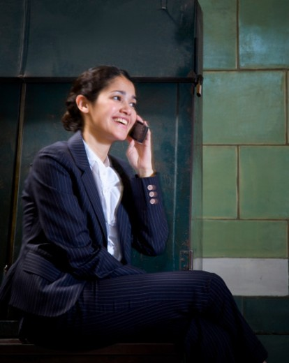 Girl enjoying her conversation on the phone. : Stock Photo