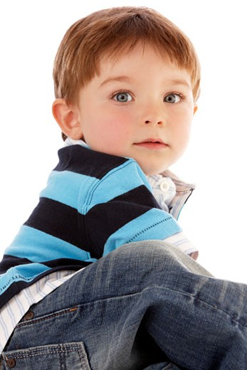 Stock Photo: 1598R-9991551 Toddler boy looking over shoulder at camera