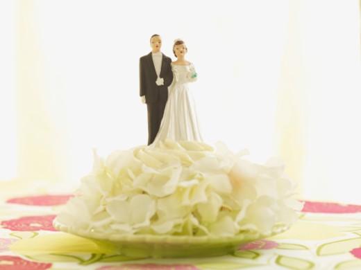 Stock Photo: 1598R-9991767 wedding cake topper on cupcake