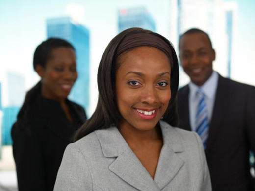 Stock Photo: 1598R-9991889 Portrait of businesswoman and team