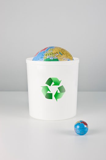 Recycling bin with globes. : Stock Photo