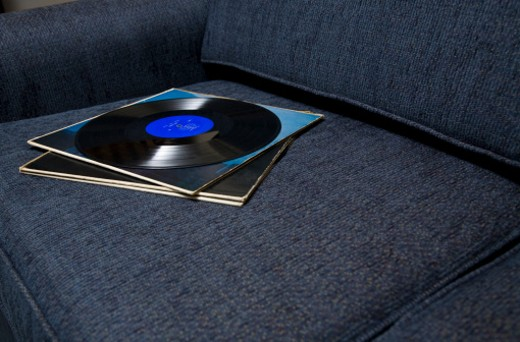Stock Photo: 1598R-9993028 Vinyl records sitting on a couch