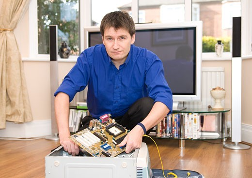 Computer engineer on a home visit : Stock Photo