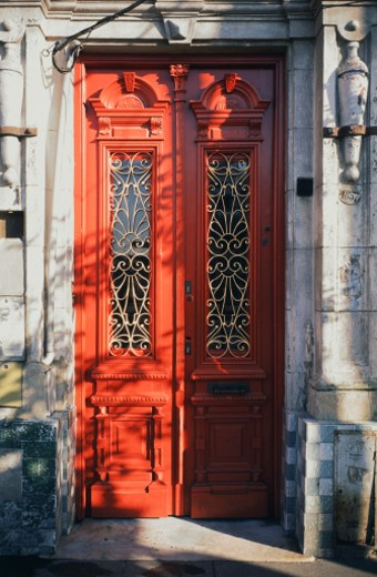 A red ornate windowed doorway with mail slot in Buenos Aires, Argentina. : Stock Photo