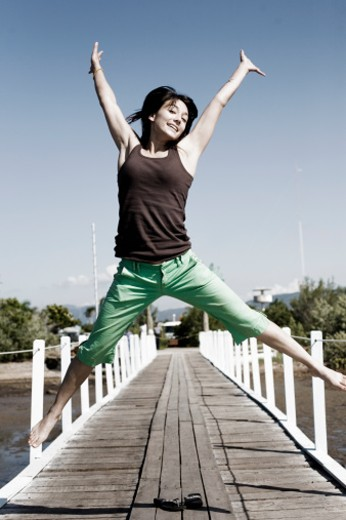 young woman leaping : Stock Photo