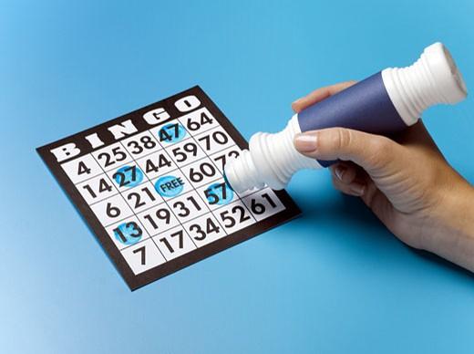 Stock Photo: 1598R-9994062 woman's hand marking bingo card