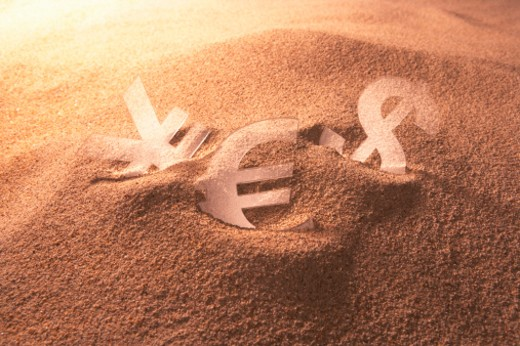 Dollar sign, Euro sign and Yen sign, Desert : Stock Photo