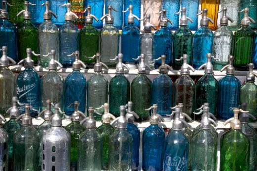 Antique seltzer bottles for sale at the San Telmo street fair in Buenos Aires. : Stock Photo