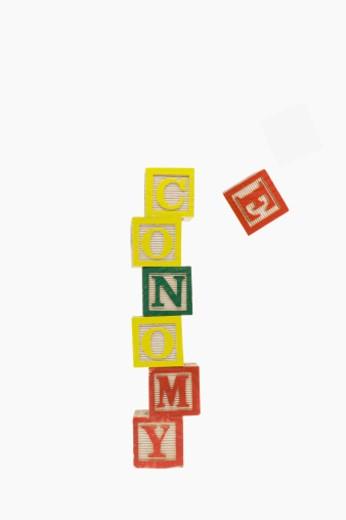 Stock Photo: 1598R-9994778 Economy in Wooden alphabet blocks