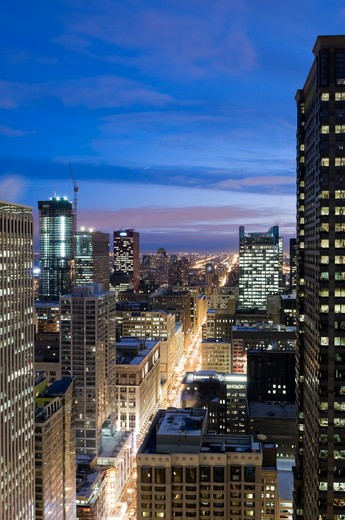 Aerial view of buildings along State Street in the Chicago Loop at dusk. : Stock Photo