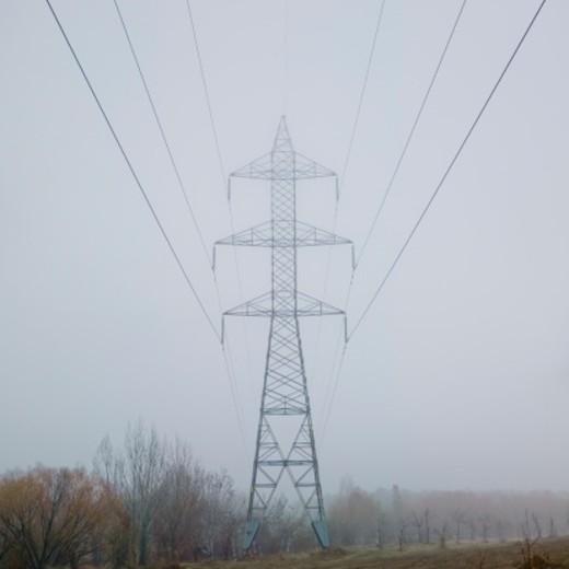 Stock Photo: 1598R-9996808 Power line under mist
