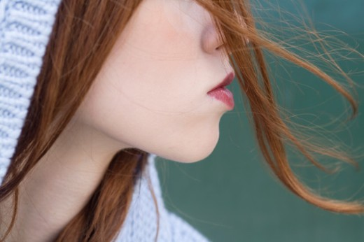 Stock Photo: 1598R-9997252 wind blown hair