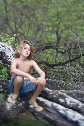 boy by creek : Stock Photo
