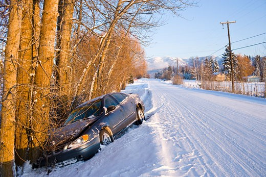 Car in ditch after winter driving in snow : Stock Photo