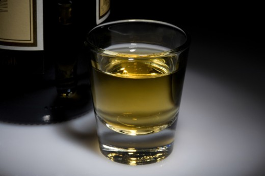 Whisky in a shotglass : Stock Photo