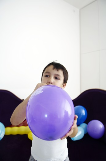 Stock Photo: 1598R-9999042 kid playing with balloons