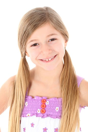 Stock Photo: 1598R-9999482 Young girl with toothy grin.
