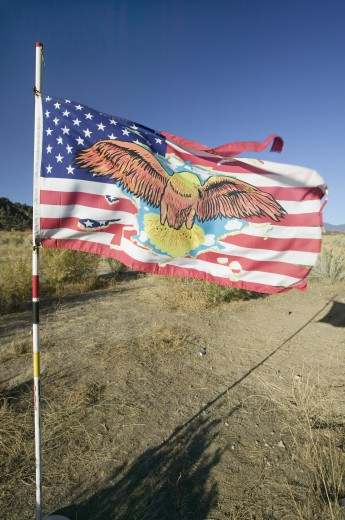 Native American Indian flag blows in wind on Chumash Indian land on highway 33, near Cuyama California : Stock Photo