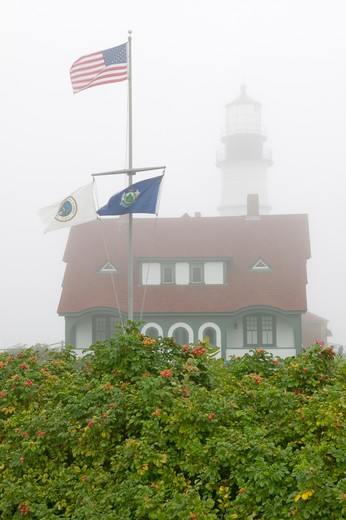 Fog shrouds the Portland Head Lighthouse in Cape Elizabeth, Maine : Stock Photo