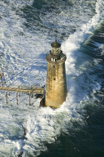 Aerial view of lighthouse at sea surrounded by water on Maine coastline, south of Portland : Stock Photo