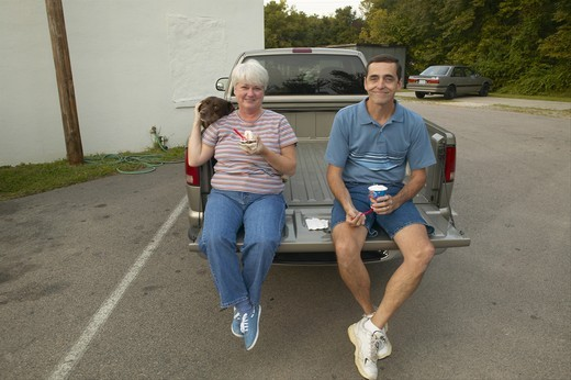 Couple eating ice cream Sunday at Dairy Queen Ice Cream shop in Central GA along highway 22 in Southeast USA : Stock Photo