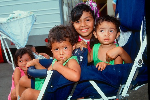 Mexican American children in a stroller, Los Angeles, CA : Stock Photo