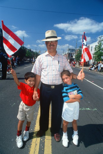 A Puerto Rican father with his sons at the Puerto Rican Festival, Wilmington, DE : Stock Photo
