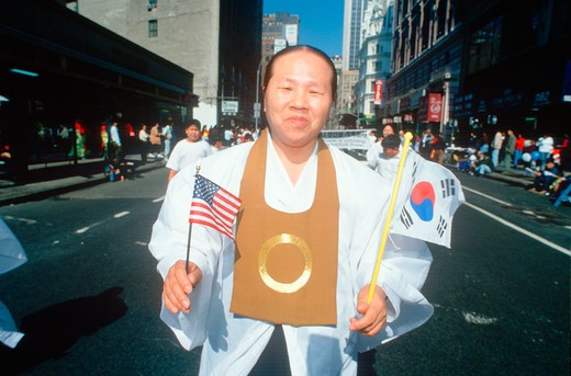 Man marching at the Korean Day Parade on lower Broadway, NY City  : Stock Photo