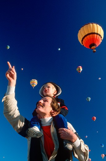 A father and son enjoying the Albaquerque Hot Air Ballon Festival, NM : Stock Photo