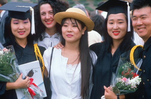 Asian-American family celebrating a college graduation, Los Angeles, CA : Stock Photo