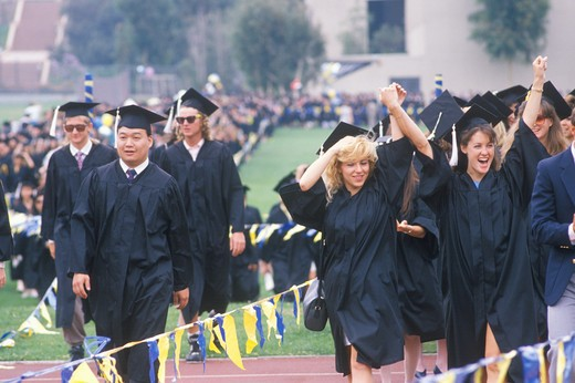 Graduating class walking towards their ceremony, UCLA, Los Angeles, CA : Stock Photo