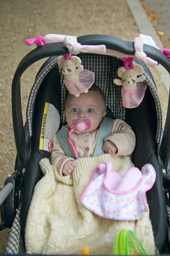 Stock Photo: 1599-13540 Baby inside carriage at park, Paris, France