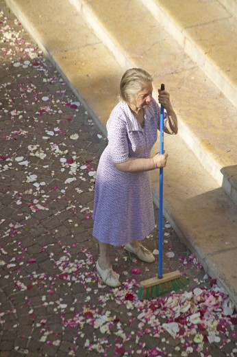 Stock Photo: 1599-13636 Woman sweeping up after Wedding Party, Antibes, France