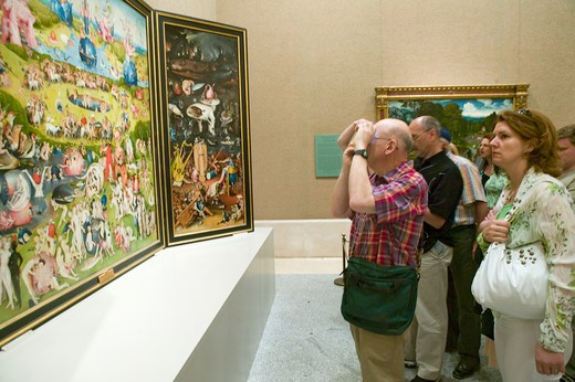 Stock Photo: 1599-13726 Man photographs 'The Garden of Earthly Delights' by Hieronymus Bosch, in the Museum de Prado, Prado Museum, Madrid, Spain