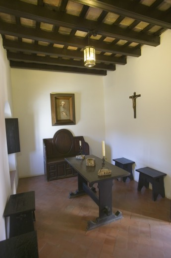 This little cell is where America was born, it is where Christopher Columbus and Franciscans met and prayed at the 15th-century Franciscan Monasterio de Santa María de la Rábida, Palos de la Frontera, the Huelva Provence of Andalucia and Southern Spain, the site where Christopher Columbus planned and departed from the Old World to the New World in August 3 of 1492 : Stock Photo