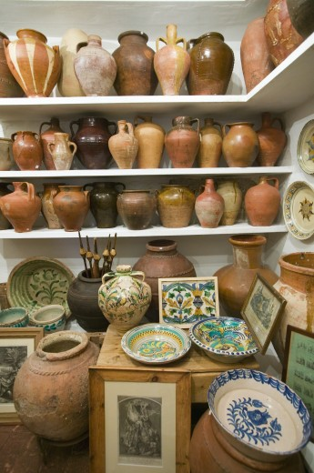 Pottery store shows stacks of old pots in old part of Centro, Sevilla Spain : Stock Photo