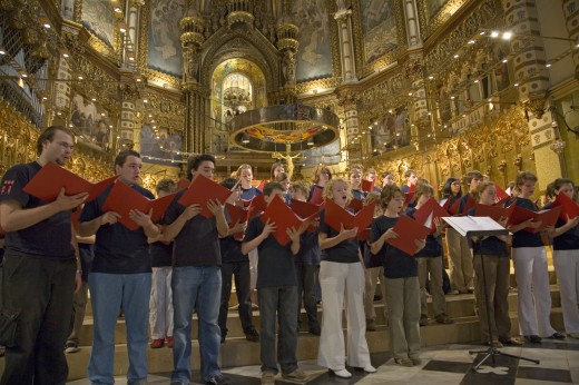 Boys & girls choir sing in the Benedictine Abbey at Montserrat, Santa Maria de Montserrat, near Barcelona, Catalonia, Spain with Black Madonna in background : Stock Photo