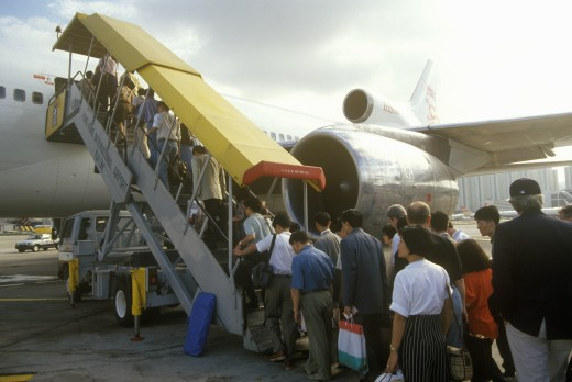 Stock Photo: 1599-14484 Executives boarding a passenger jet in Hong Kong
